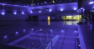 Nemalux application of color changing industrial luminaire to indicate swimming pool safety