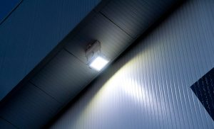 Calgary International Airport - Outdoor LED hanger high bay lighting with Nemalux RS Series industrial LED luminaire with rigid arm locked in at slight angle for stability and easy installation